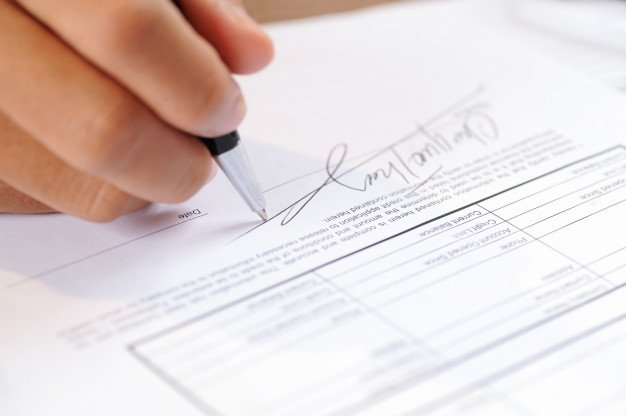 Closeup Person Signing Document With Ball Pen 1262 14867