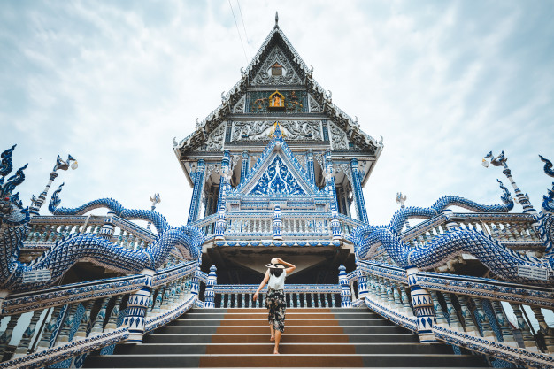Travel woman and thai temple